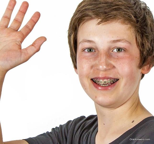 teenage_boy_gray_shirt_braces