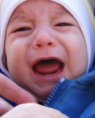 10 Signs & Symptoms of a Teething Baby